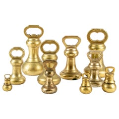 Group of Ten 19th Century Brass Handled Weights