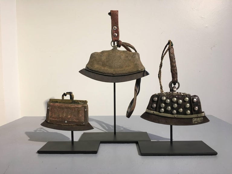 A very nice group of mounted early 19th century Tibetan leather and silver purses. The purses originally used to carry tinder and flint, with the two larger purses still containing fire starting materials. The pouches are made from leather with a