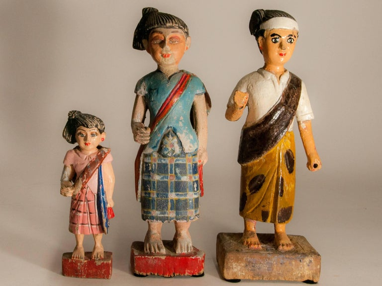 Group of three carved Nat figures or statues from Burma, hand painted, mid-20th century. Nats are local spirits represented in human form. They play a central role in Burmese folk religion. Offerings are meant to keep them placated, and shrines and