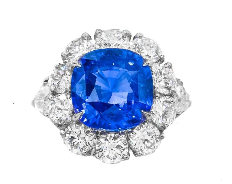 Platinum Sapphire and Diamond ring with  11.11 carats Ceylon sapphire no heat GRS certified set in halo setting with big round diamonds 5.00 carats and two GIA certified heart shapes diamond on each side, 1.00ct total.