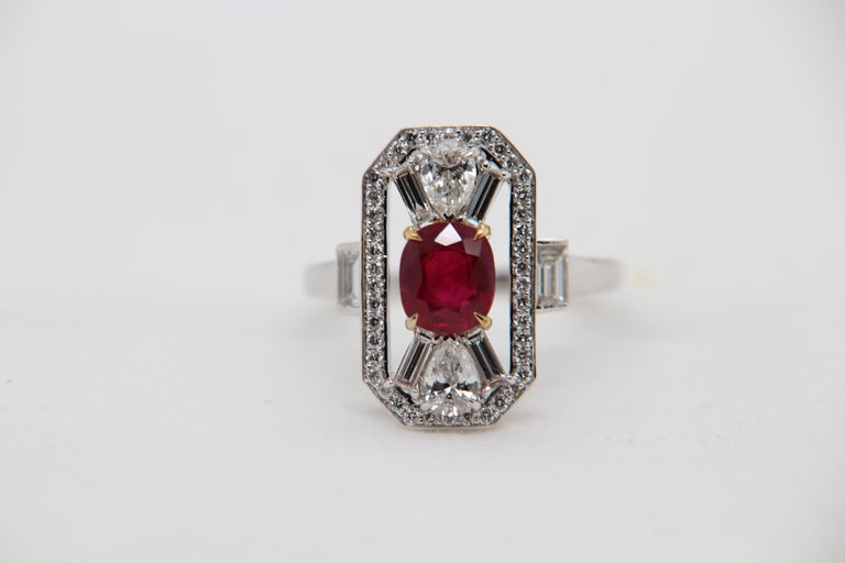 A new 1.16 carat Burmese ruby ring mounted with diamonds in 18 Karat gold. The ruby weighs 1.16 carat and is certified by Gem Research Swisslab (GRS) as natural, no heat, and 'Vivid Red Pigeon's Blood'. The total diamond weight is 1.05 carat and the