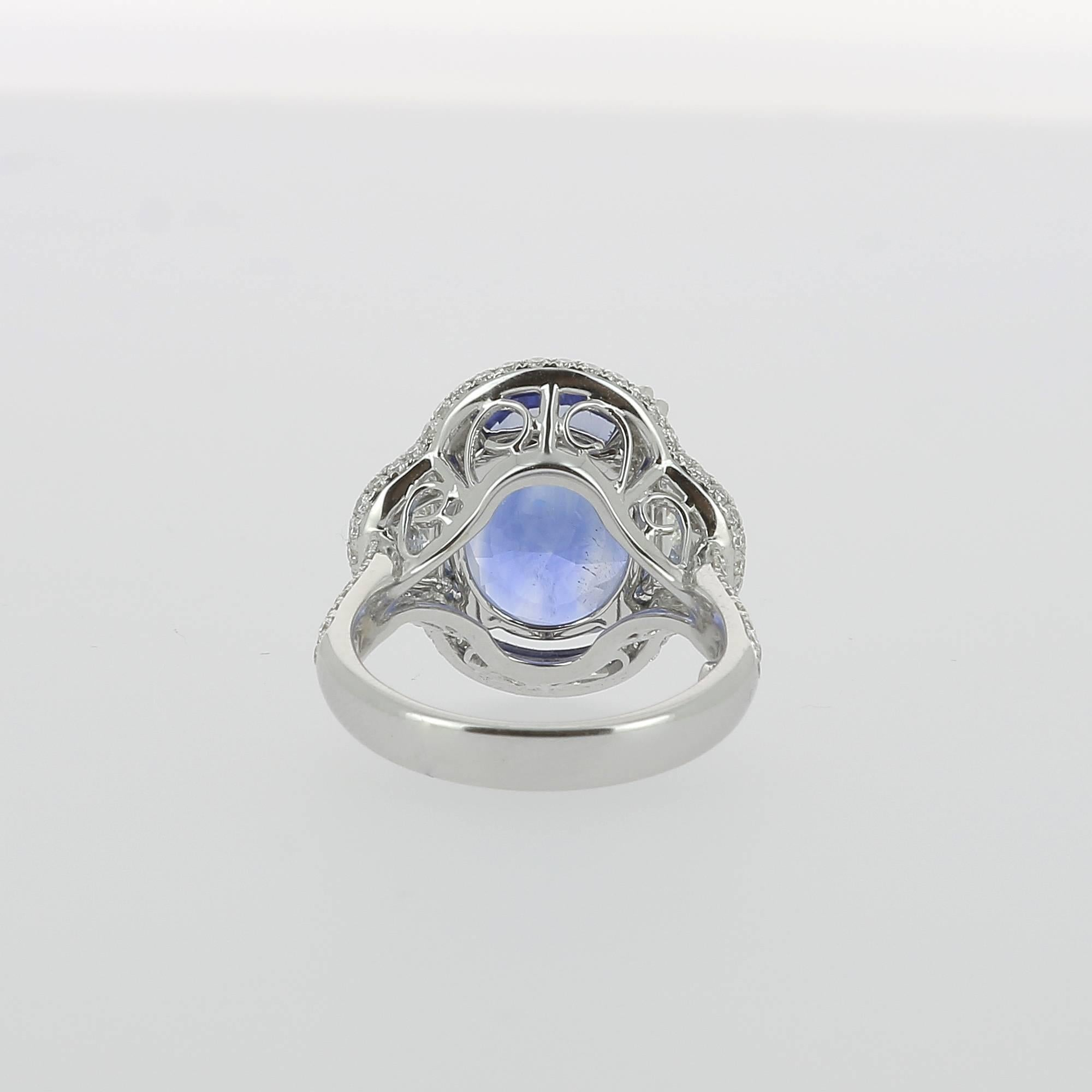 totalling gold engagement ring with fairtrade carat a and blue sapphire white diamonds
