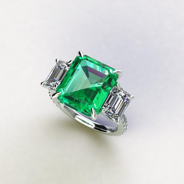 GRS Certified 6.31 carat Colombian emerald cut Emerald, very high quality color,  sided by two 1 carat Emerald white diamond, H color, VS clarity, GRS Certified embellished by a pave' of bright diamonds of approximately  total carat weight of 0.30