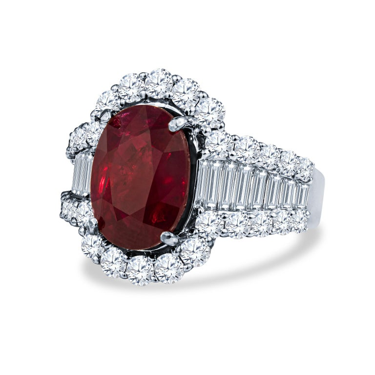 Superbly elegant ruby and diamond lady's cocktail ring handmade in 18KT white gold featuring an elongated oval natural ruby weighing 7.01 carats accompanied by GRS (Gem Research Swiss Lab) Certificate No. GRS2015-110255 stating that the gemstone