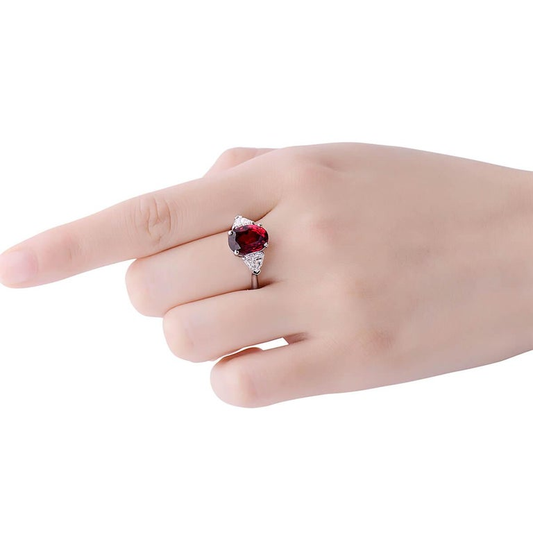 This stunning solitaire ring hosts a main natural untreated 4.78 Carat vivid red ruby between two natural white diamonds making up a total carat weight of 5.73 Carats. It is GRS Certified.  Only suitable for people looking to make a statement and