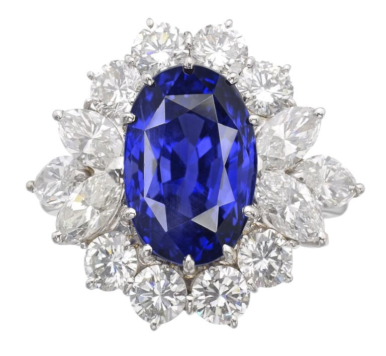 This lovely rectangular oval-cut unheated Ceylon blue sapphire weighing 5 carats, is framed with a halo of 8 round brilliant-cut diamonds and 5 pear cut diamonds, totaling approximately 1.50 carats.   Set in platinum, Accompanied by GRS Switzerland