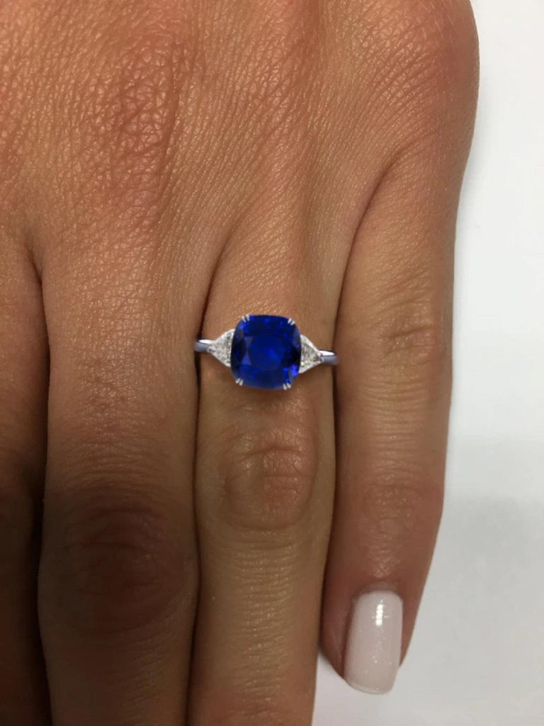 An important sapphire and diamond ring handmade in Italy. With it's deep royal blue glow and intense hue, we could liken it to the heavenly bodies or to the oceanic depths with equal fairness. It is a truly remarkable gem with FLAWLESS yes FLAWLESS