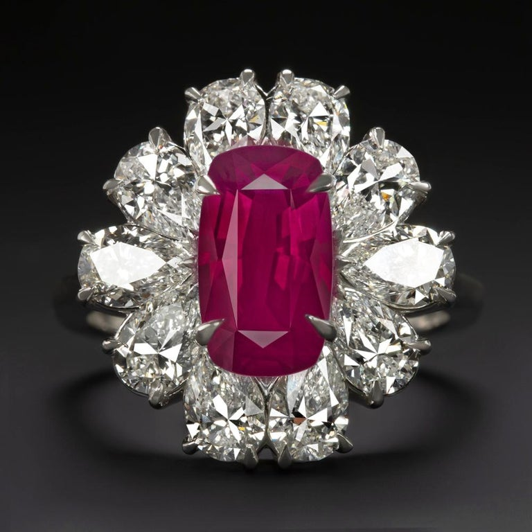 Elegance meets glamour in this spectacular cocktail ring from the Antinori Fine Jewels.   At its centre is a captivating bright vivid red peagon's blood ruby, hailing from Mozambique and cut in a sophisticated step cut shape.   The exquisite ring is