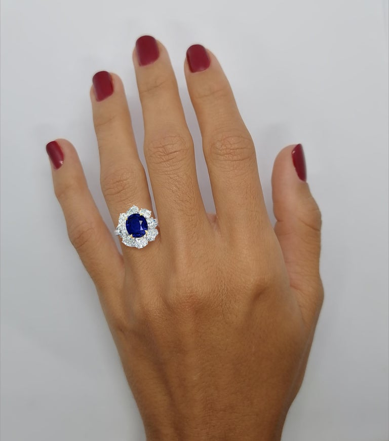 GRS SWITZERLAND Royal Vivid Blue 3.80 Carat Oval Sapphire Diamond Cocktail Ring  VS1 Clarity color is vivid blue also written in the certificate which is quite rare absolutely no treatment and no heat  the side oval diamonds are very pure as