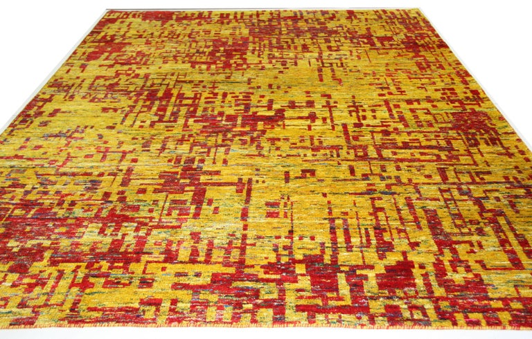 Grunge Red rug, multiple sizes  One of Aga John's most popular contemporary designs. Bold tones of red, yellow and gold combine to bring a color pop to your space. Hand-knotted viscose gives a silky smooth feel to the touch. Hand made in India.