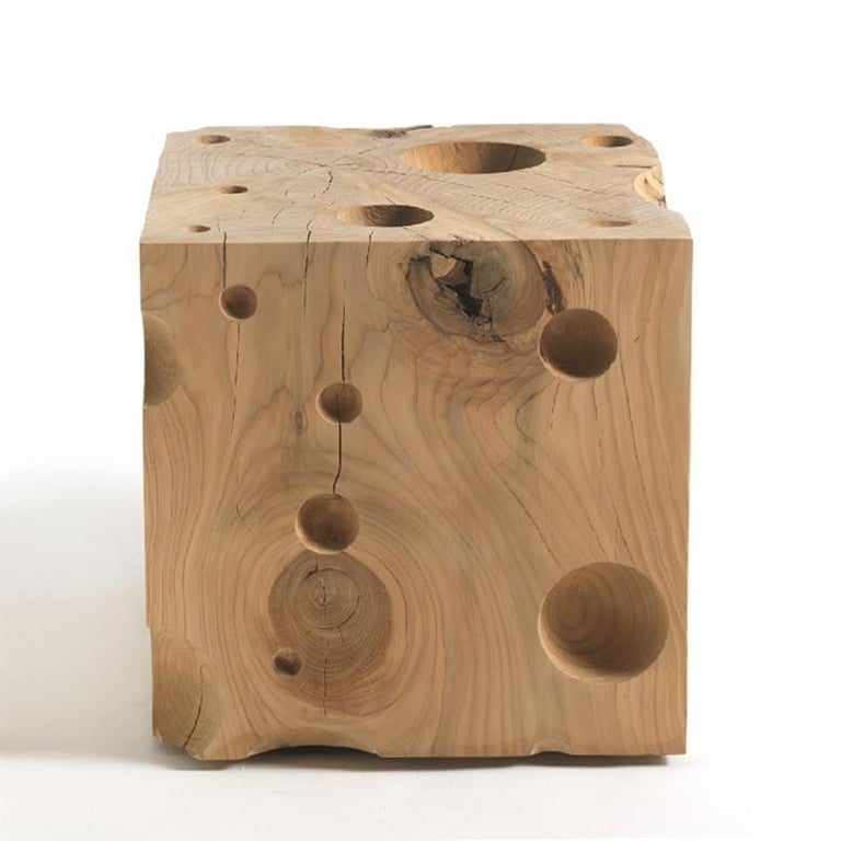 Stool Gruyère made in natural solid cedar wood with natural pine extract wax treatment. Original subtle decoration piece. Solid cedar wood include movement,  cracks and changes in wood conditions,  this is the essential characteristic of natural