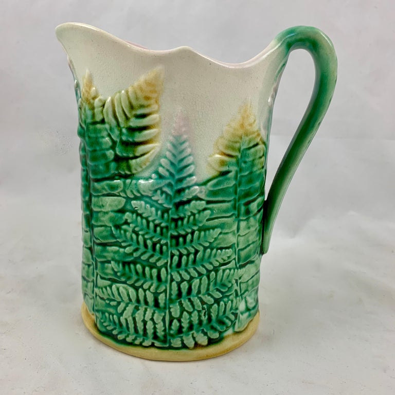 A scarce Etruscan majolica Fern pitcher, by Griffen, Smith & Hill, circa 1880-1885.  Founded in Pennsylvania, GS&H is the best known of the American majolica potteries. The name Etruscan, borrowed from Josiah Wedgwood's Etruria line, was inspired