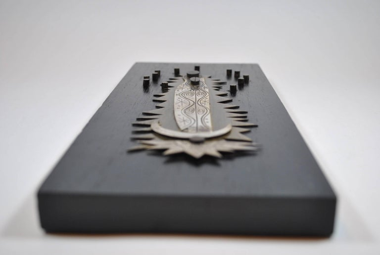 """Abstract """"Guadalupe Virgin"""" made of silver, mixed metals and ebony. Made by Benedictine monks at """"Talleres Monásticos Cuernavaca"""", since the early 1960s. The workshop (now extinct) developed very well crafted abstract liturgical work depicting"""