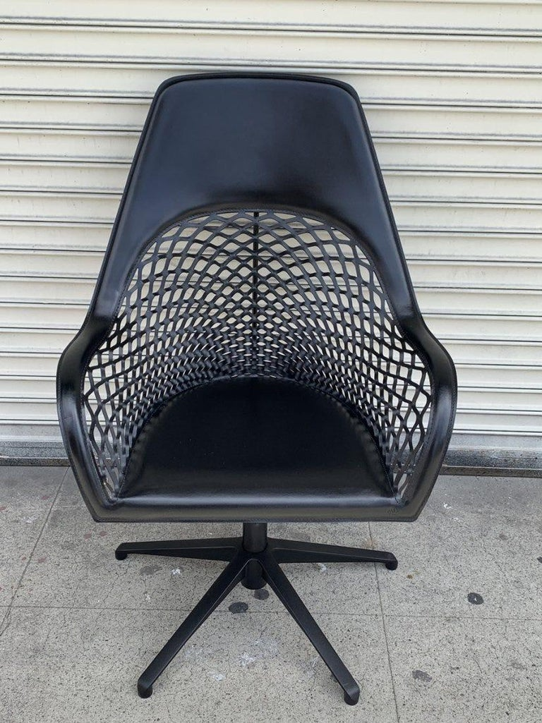 Beautiful leather chair designed by Semperi Poli and manufactured in Italy by MIDJ SPA.  The Guapa DPA is a swivel and height adjustable armchair with five-star base in lacquered steel.  Height adjusting mechanism integrated. The chair is