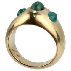 Gübelin 18 Karat Gold and Emerald Cabochon Three-Stone Ring