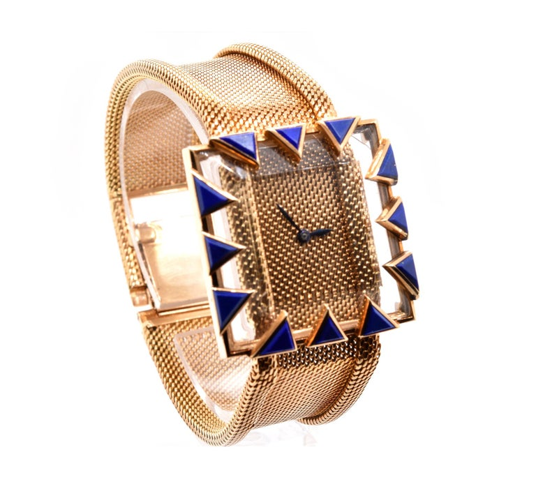 Movement: manual Function: hours, minutes Case: 32mm 18K yellow gold, acrylic and lapis protective crystal Band: 18K yellow gold mesh bracelet, bracelet will fit a 6.5-7.5 inch wrist Dial: gold mesh dial Serial #: 141XXX  Engraved: WM.E.SLAUGHTER