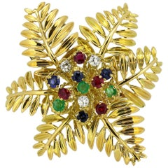 Gubelin, 18kt Gold Brooch with Diamonds Emeralds Sapphires Rubies and Emeralds