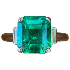 Gübelin Certified 4.52 Carat Colombian Emerald and Diamond Engagement Ring