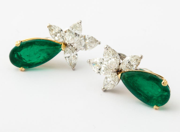 The beautifully matched pair of 5 carat Colombian emeralds hang delicately off of marquise diamond clusters in an elegant and timeless fashion.    1 pear shape emerald 5.03cts (Gubelin certificate) 1 pear shape emerald 5.61cts (Gubelin