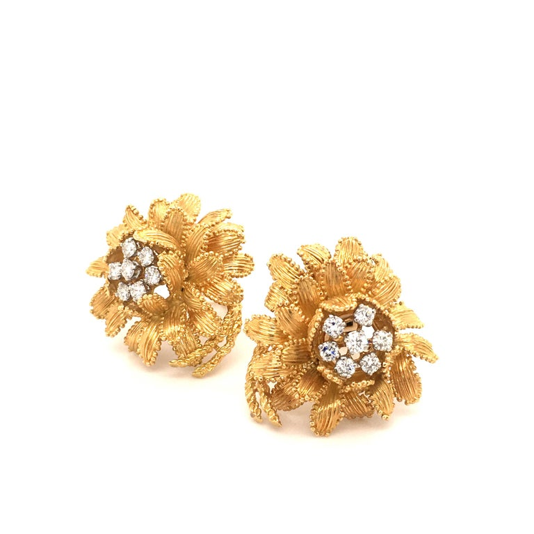 This beautifully handcrafted flower earclips by Gubelin in 18 karat yellow and white gold are prong set with 14 brilliant cut diamonds of G/H color and vs clarity, total weight 0.93 carats.  Each leaf is carefully bordered by minute granulated