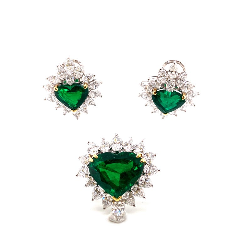 Gubelin Lab Certified Heart Shaped Emerald and Diamonds Ring and Earrings Set:   A very important set of ring and earrings, it features a stunning Gubelin Lab certified 13.66 carat heart-shaped emerald surrounded by a halo of super-fine white pear