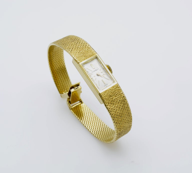Modern and classic women's gold wrist watch. It has an elegant rectangular dial on a textured gold bracelet, Swiss made and timeless design. The movement is beautiful and works well, it just needs a new arm. It has a nice feeling to wear because of