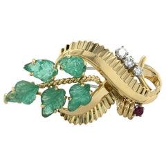 Gübelin Retro Brooch in 18 Karat Gold with Emeralds, Diamonds, and Ruby