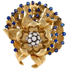 Gübelin Swiss Mid-20th Century Diamond Sapphire and Gold Flower Brooch