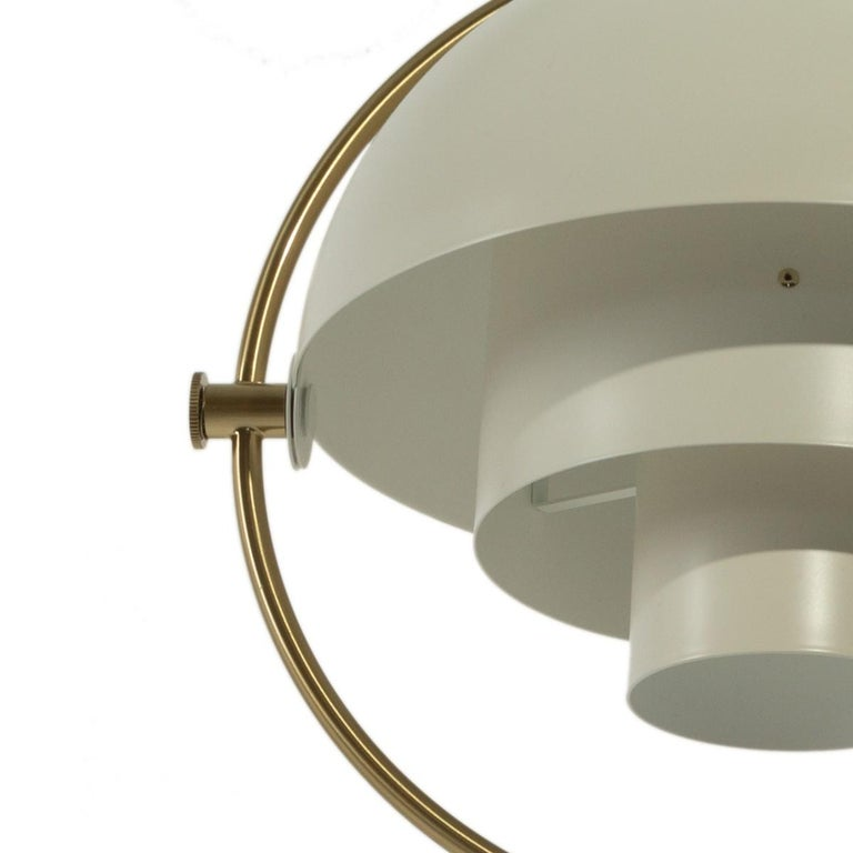 A Gubi Multi-Lite white metal and brass pendant light by Louis Weisdorf, Germany, circa 1970.   Canopy size: 4.5 inches x 2.3 inches.