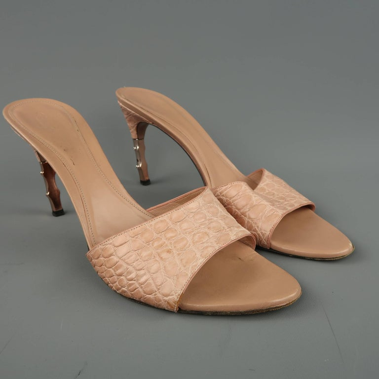 4ba8062d4ac GUCCI mule sandals come in a dusty rose pink alligator textured leather  with a half covered