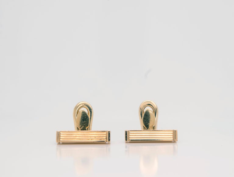 Vintage Gucci 18 Karat Gold Bar Cufflinks  Finish off your black-tie look sporting these Iconic Gucci bar cufflinks in 18k gold featuring a multi-line motif. Dimensions:14mm x 3.10mm Stamped ITALY GUCCI 750