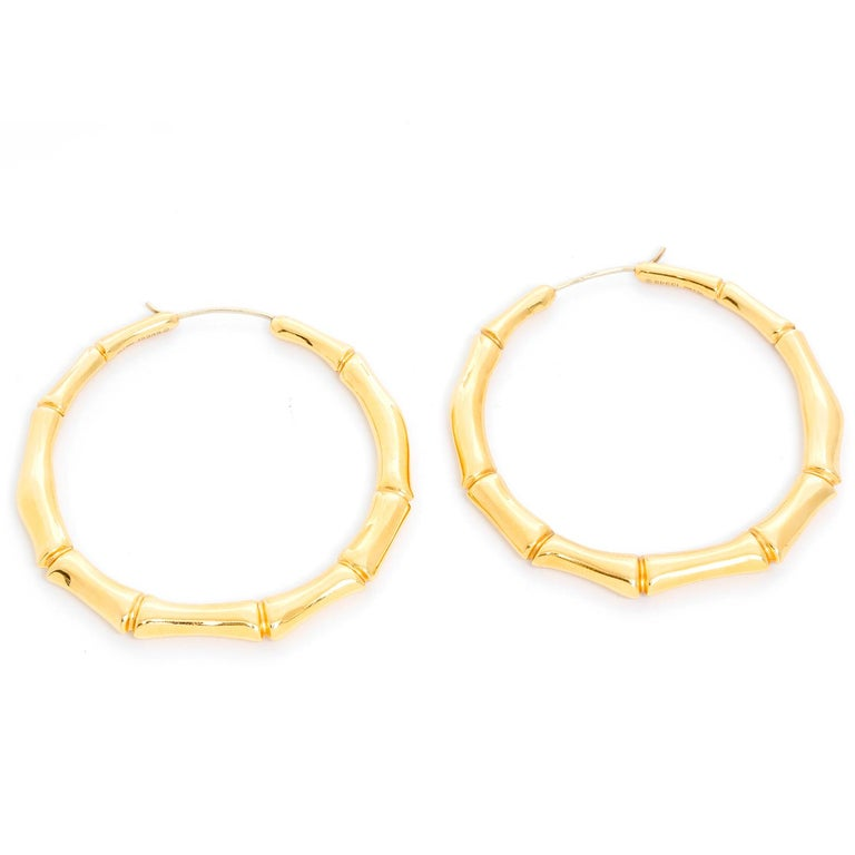 3e4277c65 Gucci 18K Yellow Gold Bamboo Hoop Earrings - The graceful form of the bamboo  plant has