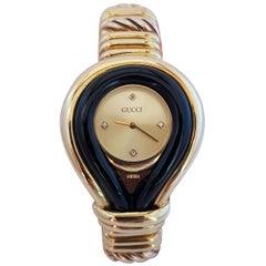 Gucci 18 Karat Gold, Diamonds and Onyx Watch