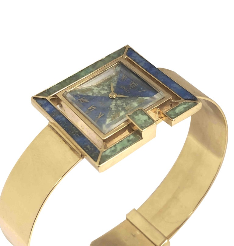 Circa 1960s Gucci 18k Yellow Gold Bracelet Wrist Watch, The watch in the Form of a