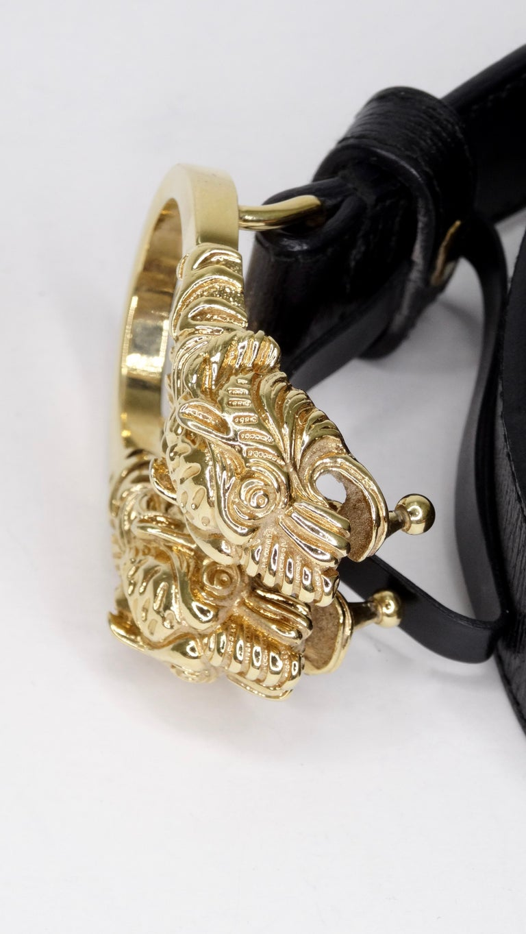 Score yourself a piece of classic Gucci with this amazing belt! Circa 1980s, this black leather belt features a Dionysus antiqued gold buckle-a unique detail referencing the Greek god Dionysus, who in myth is said to have crossed the river Tigris on