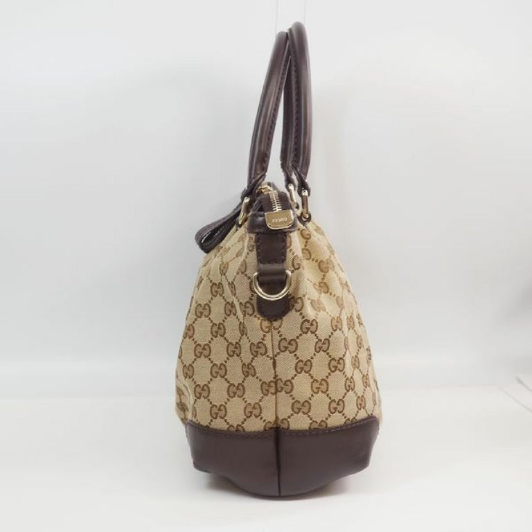 An authentic GUCCI 2way shoulder bag Womens tote bag 247902 beige x brown. The color is beige x brown. The outside material is GG canvas/ leather. The pattern is 2way  shoulder bag. This item is Contemporary. The year of manufacture would be