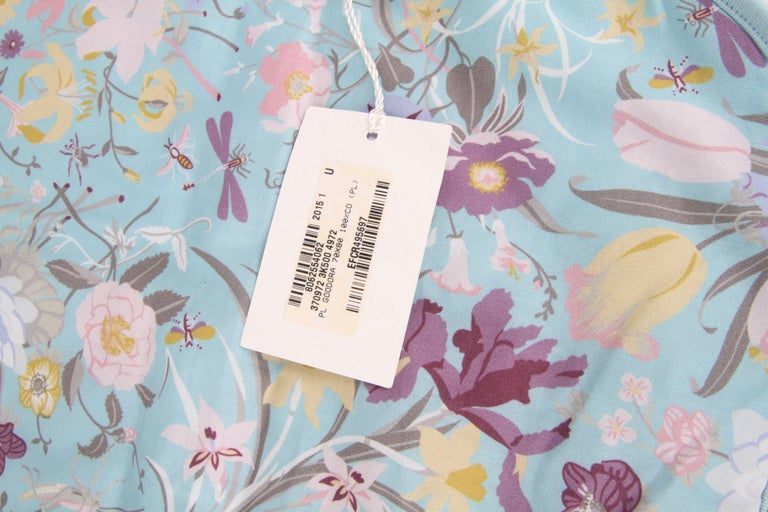 Gucci Baby Blue Floral Blanket.  This stunning blanket from Gucci is crafted out of fine cotton. This scarf features a classic Gucci design with floral pattern and the iconic monogram throughout.  New with tags.  Materials: 100%