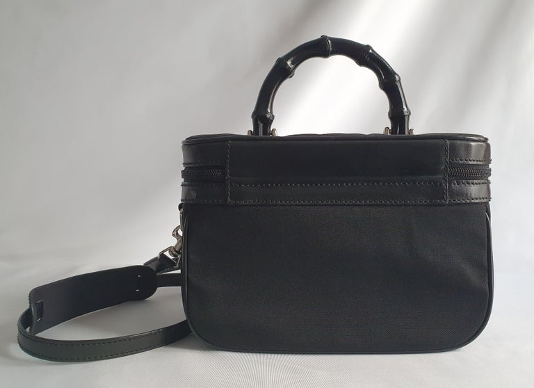 - Designer: GUCCI - Model: Bamboo - Condition: Very good condition. Scratches on the clasp, Bag restored by a professional - Accessories: None - Measurements: Width: 24cm, Height: 16cm, Depth: 13cm, Strap: 121cm - Exterior Material: Cloth - Exterior