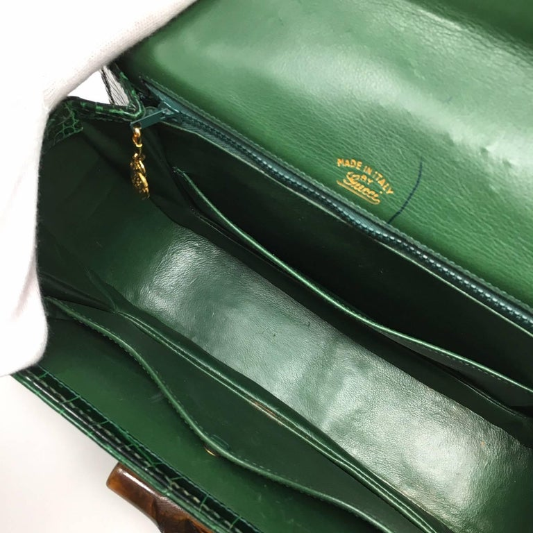 4ee5bbc245c Iconic and Rare Gucci Bamboo Vintage Bag in Green Crocodile Leather. The Bag  has a