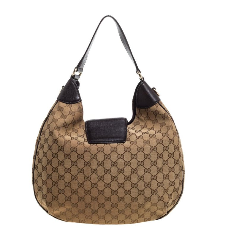 Loaded with Gucci's timeless design elements, this Dressage hobo is built to be a great style companion. Crafted from GG canvas and leather in Italy, this gorgeous number has a tuck-in flap that opens up to a spacious canvas interior. Complete with