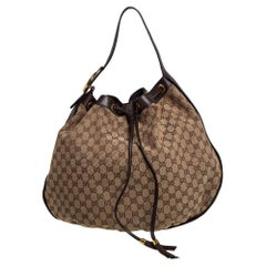 Gucci Beige/Brown GG Canvas and Leather Interlocking Icon Drawstring Hobo