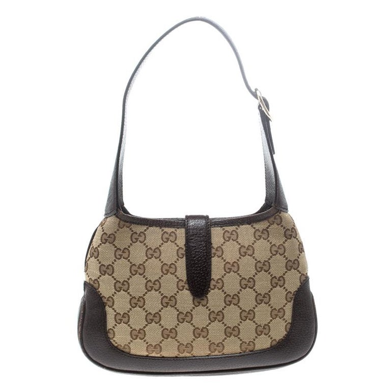 8bc0a3cadbabb9 Gucci Beige/Brown GG Canvas and Leather Mini Jackie Hobo For Sale.  Well-structured and lovely to look at, this mini Jackie hobo will perfectly  complement
