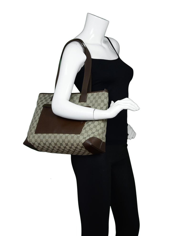 Gucci Beige/Brown Monogram Canvas/Leather Zip Top Tote Bag W/ DB  Made In: Italy Color: Beige/brown Hardware: Silvertone Materials: Canvas and leather Lining: Brown textile  Closure/Opening: Zipper top Exterior Pockets: Front zippered