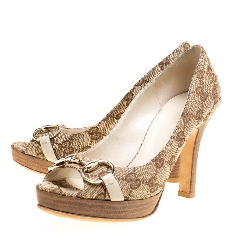 898a6a2ed14 Women s Gucci Beige GG Canvas Horsebit Peep Toe Platform Pumps Size 35.5  For Sale