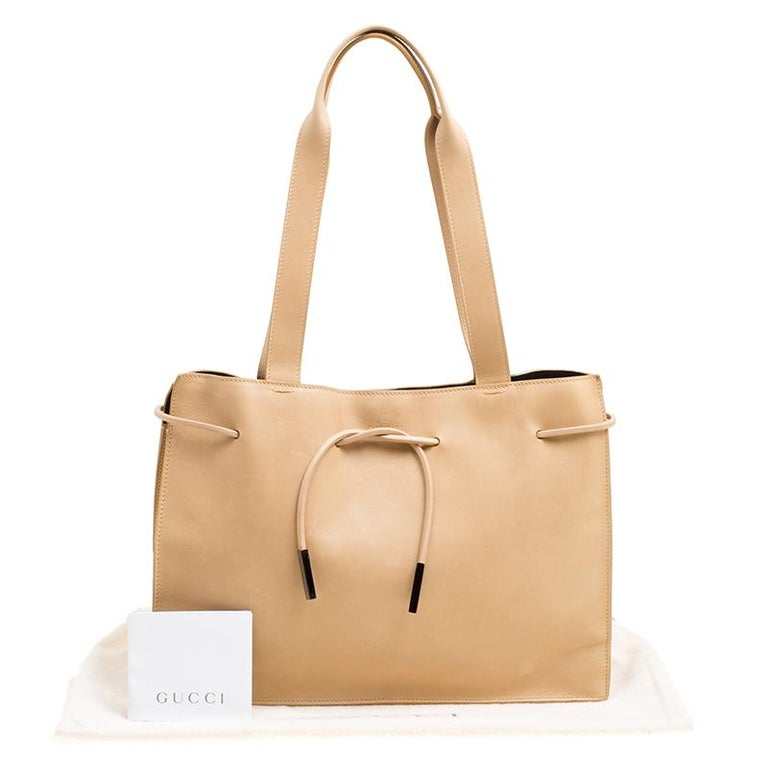 0ab7c3735fb Gucci Beige Leather Tie Top Tote at 1stdibs