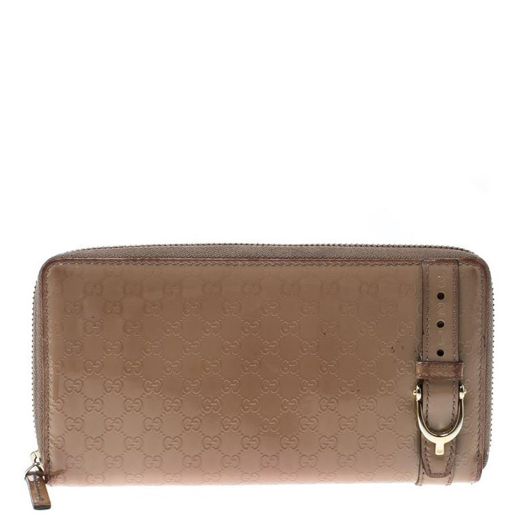 1e046d6829c Gucci Beige Micro Guccissima Patent Leather Zip Around Wallet at 1stdibs