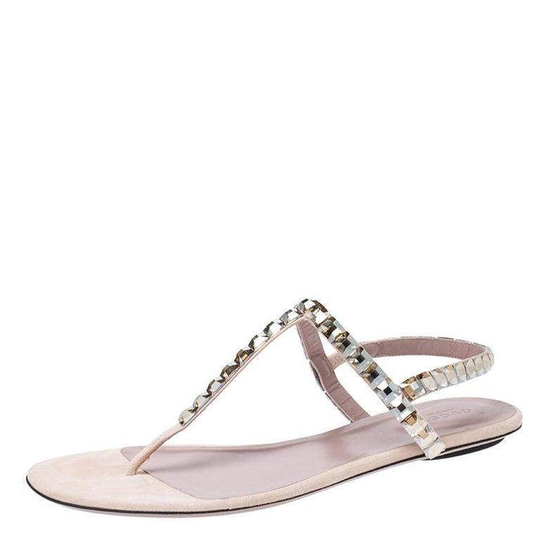 These sandals have a thong design in suede with crystals detailed on the straps. They feature buckle closure at the ankle, leather insoles and durable soles. The light colours make them visually pleasing.  Includes Original Dustbag, Original Box