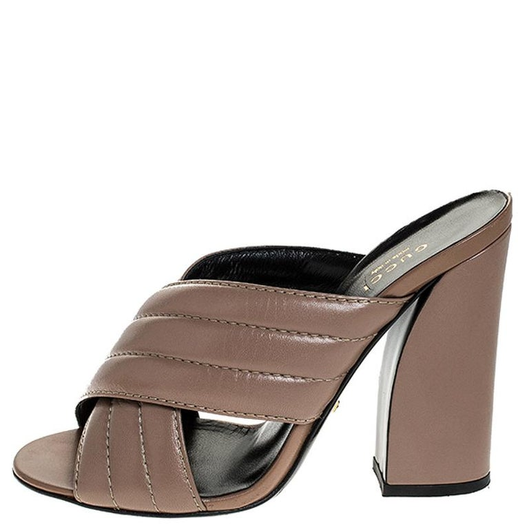 Mules are a raging trend these days. Hurry and join the style wave today with these mules from Gucci. Crafted from leather in a sleek beige shade, they have been styled with two crossover straps and block heels. The insoles have also been lined with