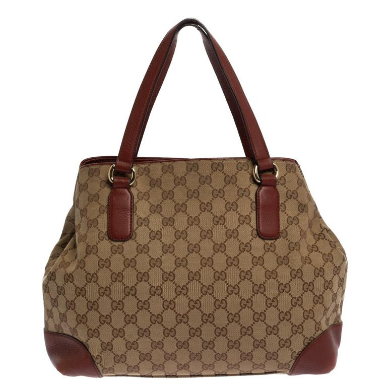 Loaded with Gucci's timeless design elements, this Dressage tote is built to be a great style companion. Crafted from GG canvas and leather in Italy, this gorgeous number has a spacious fabric interior. Complete with two handles, this tote is ideal