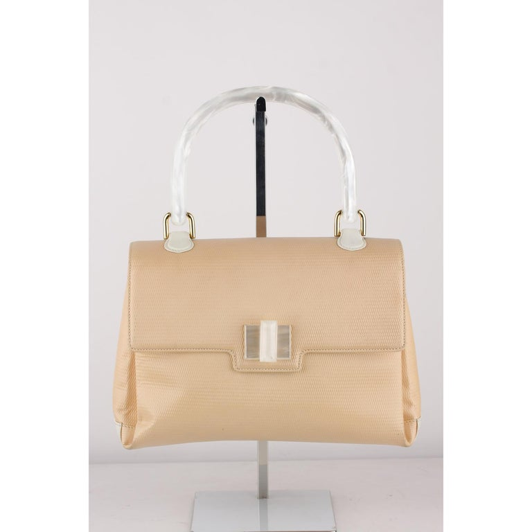Gucci Beige Textured Leather Handbag with Lucite Handle  Material : Leather  Color: Beige Model: Handbag Gender: Women Country of Manufacture: Italy Size: Small Bag Depth: 3.75 inches - 9,5 cm  Bag Height: 7 inches - 17,8 cm  Bag Length: 10 inches